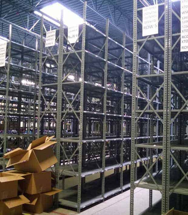 "Used steel shelving 24"" deep x 36"" wide standing in warehouse"