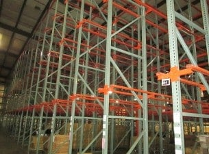 Used Interlake drive-in rack standing in warehouse.
