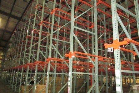 Used Interlake drive-in rack standing in warehouse.