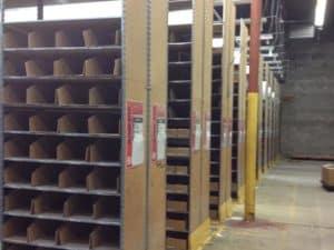 "Used 24"" deep Lozier backroom shelving"