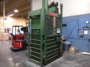 Used PTR cardboard baler in warehouse