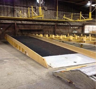Used yard ramp on warehouse floor.
