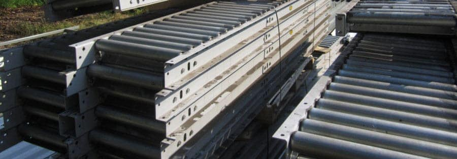 Used gravity conveyor stacked and banded