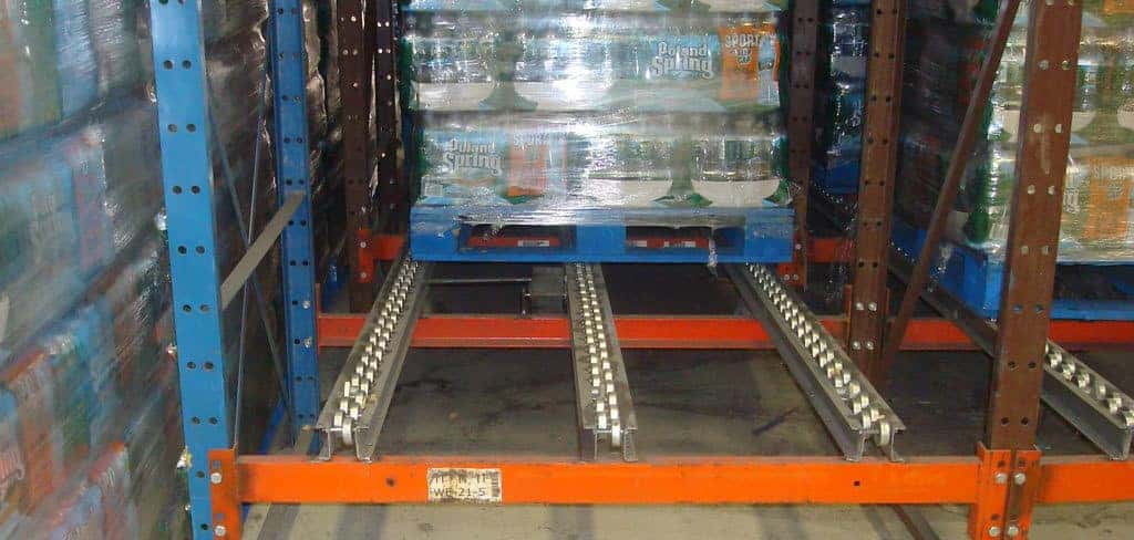 Pallet flow rack system loaded with a pallet of goods
