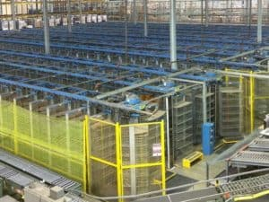 Used Diamond Phoenix horizontal carousels for sale - shown standing in warehouse.