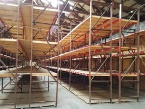 "Used Frazier Structural Rack standing - 40"" deep x 14' tall frames and 108"" x 3"" long Frazier structural beams"