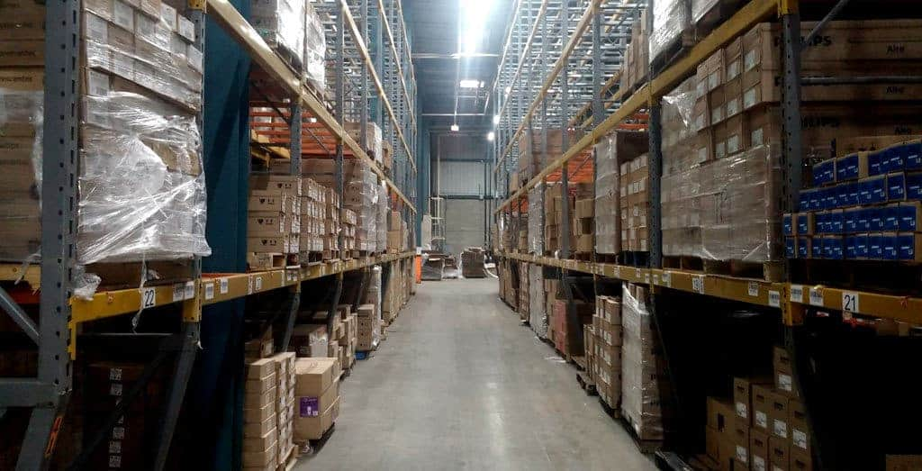 Aisle view of heavy duty pallet rack storing product in warehouse