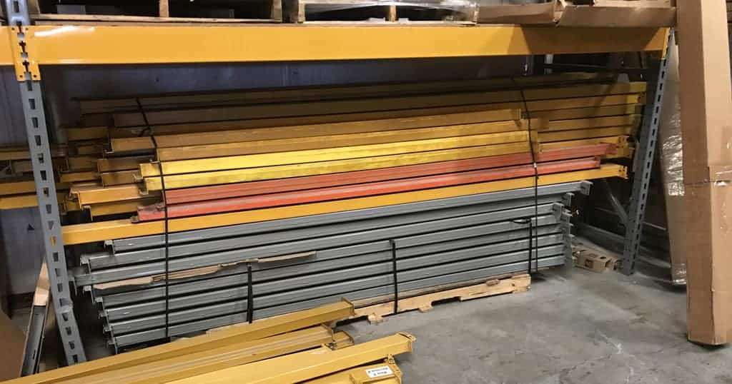 Keystone style beams stacked in racking
