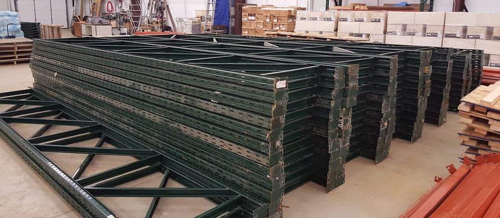 "Used 36"" x 18' Ridg-U-Rak uprights down and stacked on floor"