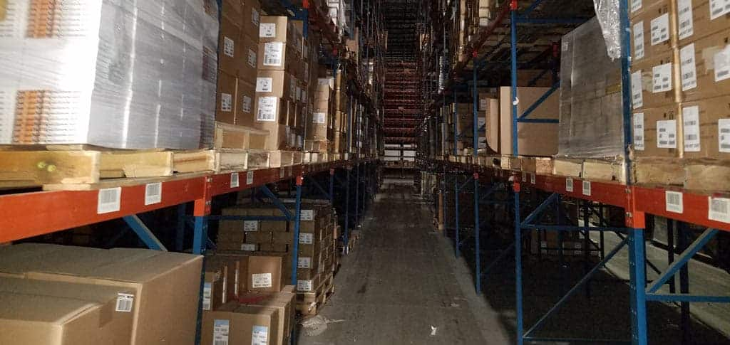 Aisle view of structural rack storing product