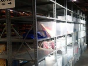 Gray nut & bolt steel shelving side view in a warehouse