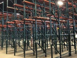 Ridg-U-Rak brand drive-in rack standing in warehouse.