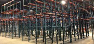 Ridg-U-Rak brand drive-in rack standing in warehouse.