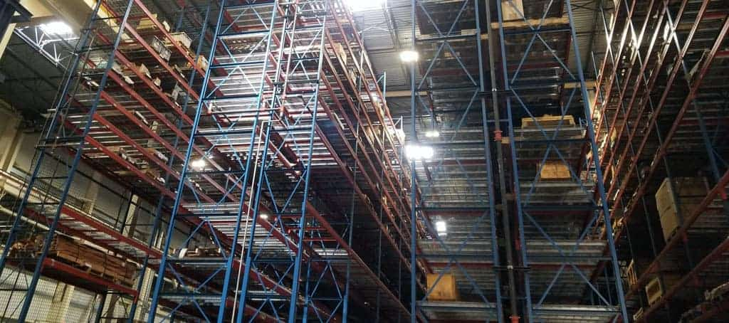 Tall pallet rack view from below.