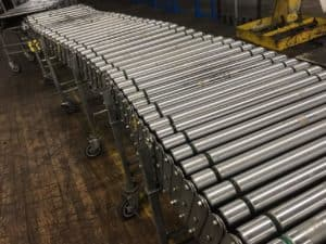 Used NestaFlex power roller conveyor in warehouse