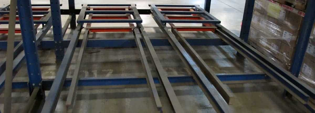 Pushback rack carts and rails with no product loaded