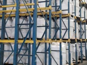 Blue and yellow drive-in pallet rack in distribution center