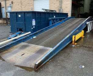 Used Bluff Manufacturing yard ramp shown at loading dock