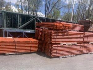 Structural pallet rack frames and beams down, stacked and banded