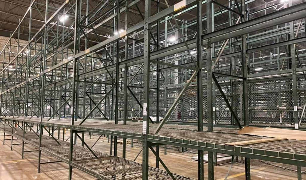 Green structural pallet racking installed in warehouse