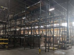 Used T-Bolt pallet rack installed in warehouse